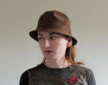 model topi kulit wanita